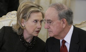 Hillary Clinton speaks with the US Middle East peace envoy, George Mitchell, during talks in Moscow