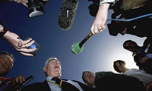 Journalists gather for a quote from Ian Paisley