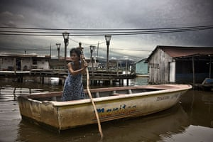 Venezuela lightning: A resident of Congo Mirador uses a boat on Lake Maracaibo
