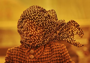 Sandstorms in China: A woman covers her face against a sandstorm in Tianjin municipality