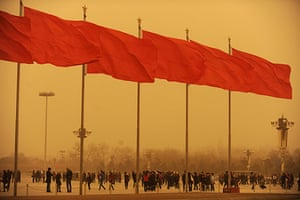 Sandstorms in China: People walk in Tiananmen square during a sandstorm