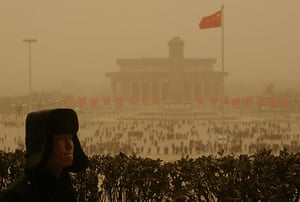 Sandstorms in China: A paramilitary policeman stands guard on Tiananmen Gate amid a sandstorm