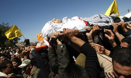 Palestinians carry the bodies of Mohammad Qadus and Osaid Qadus