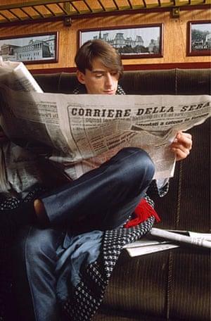 Paul Weller Timeline: Paul Weller of The Style Council reading an Italian newspaper