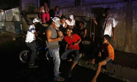 People gather outside their homes during the daily two-hour blackout in Venezuela