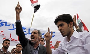 Supporters of prime minister Nouri al-Maliki protest outside local government offices in Basra