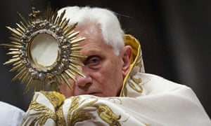 Pope Benedict holds host
