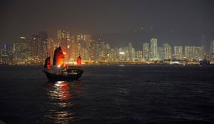 Earth Hour: A traditional Chinese boat floats on Victoria harbour during Earth Hour