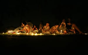 Earth Hour: People sit in a park in Singapore's financial district during Earth Hour