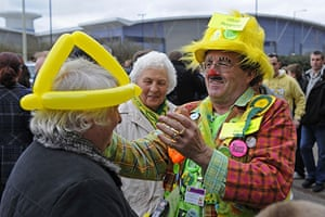 Norwich v Leeds: A clown outside Carrow Road dishes out balloon hats