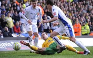 Norwich v Leeds: Stephen Elliott slides in and nicks the ball away from Neil Kilkenny