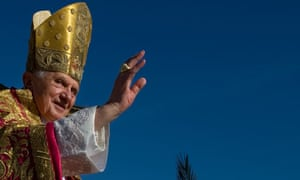 Pope Benedict XVI waves as he arrives in St Peter's Square at the Vatican Palm Sunday mass