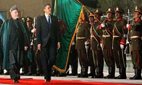 Barack Obama inspects a guard of honor with Hamid Karzai in Kabul