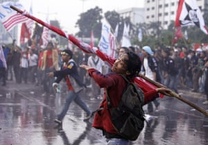 24 hours: Jakarta , Indonesia: A protester throws a pole towards police