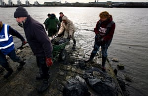 Cleaning the Thames: Volunteers working at North Woolwich