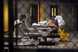 Guantanamo Bay: Unidentified detainees clean the common area