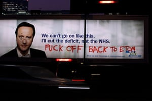 Election posters: A vandalised billboard poster of Conservative party leader David Cameron