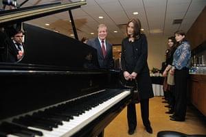 Sarkozy in the US: Carla Bruni-Sarkozy visits a music classroom at Julliard School