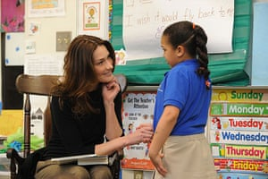 Sarkozy in the US: Carla Bruni Sarkozy visits with a child at a KIPP school