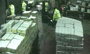CCTV image of the £1.75m armed robbery of the Menzies warehouse at Heathrow airport
