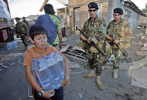Chile Aid: Chilean Army distributes water bottles in Talcahuano, Chile