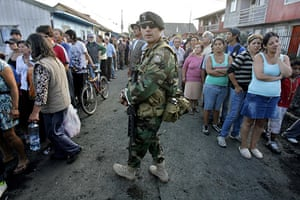 Chile Aid: People line up as Chilean Army distributes water bottles, Talcahuano, Chile