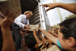 Chile Aid: Chilean businessman Leonardo Farkas distributes food to residents in Chile