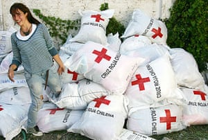 Chile Aid: A volunteer organizes bags of clothes from the Chilean Red Cross