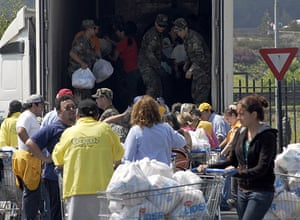 Chile Aid: Chilean soldiers distribute packages of food to earthquake survivors, Chile