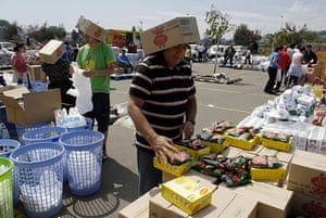 Chile Aid: Workers separate donated food into packages for distribution in Chile