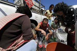 Chile Aid: Members of the Chilean Agriculture Ministry distribute drinking water