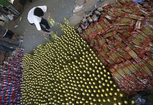 Chile Aid: A volunteer sorts bottles of cooking oil in Chile