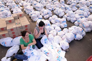 Chile Aid: Volunteers pack food donated for Saturday's earthquake victims in Chile