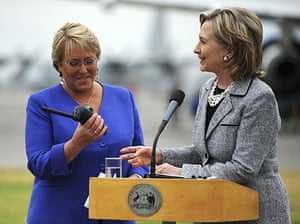 Chile Aid: Chiles President Michelle Bachelet and Hillary Clinton hold satellite phone