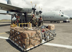 Chile Aid: Chilean soldiers arrive with aid for earthquake victims in Concepcion