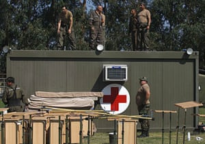 Chile Aid: March 3, 2010: Military personnel set up a field hospital in Chile