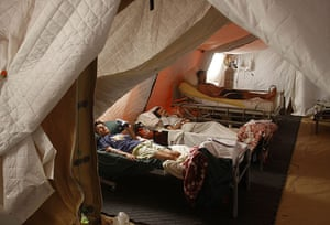Chile Aid: March 1, 2010: Earthquake victims lie in beds in a field hospital