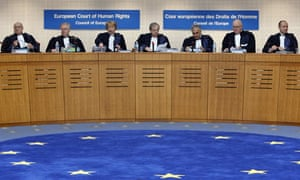 Judges arrive at the start of the Yukos versus Russia case at the European Court of Human Rights