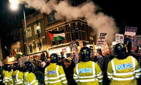 Police square off with protesters at the Israeli embassy in London last January