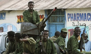 Transitional Federal Government soldiers sit in their truck in Bur Haqaba,  Somalia