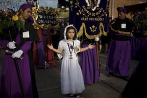 Holy week: Guatemala City: A girl gestures during a Holy Week procession