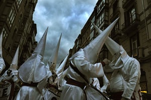 Holy week: Bilbao, Spain: Penitents prepare their costumes before a procession