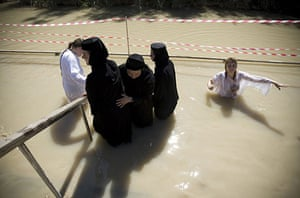 Holy week: Orthodox Christians immerse themselves in the Jordan River