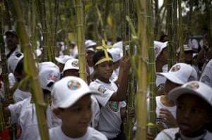 Holy week: Caracas, Venezuela: Children carry palm leaves in Palm Sunday services