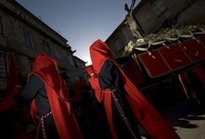 Holy week: Santiago de Compostela, Spain: Penitents in the Esperanza procession