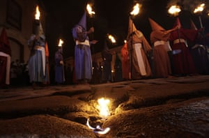 Holy week: Cidade de Goias, Brazil: Penitents attend the Procession of the Torches