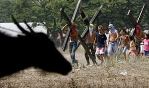 Holy week: Angeles city, Phillipines: Penitents carry wooden crosses