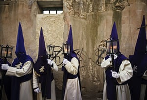 Holy week: Zamora, Spain: Penitents wait to take part in a procession