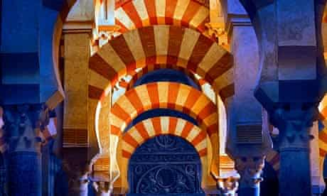Red and yellow archways in the Cordoba mosque