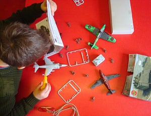 in pictures: hobbies: boy making airfix model